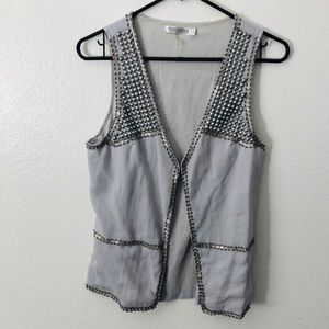 Small grey vest with metal details